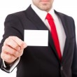 Business man showing a blank business card over white background — Stock Photo