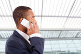 African American business man speaking on the cellphone at moder — Stock Photo