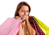 Portrait of a beautiful woman holding shopping bags, isolated on — Stock Photo