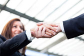 Businesspeople shaking hands at the office — Stock Photo