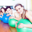 Stock Photo: Group of in a class of Pilates at the gym