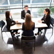 Business partners discussing ideas at meeting — Stock Photo #21724135