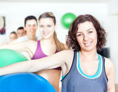 Group of holding pilates ball at the gym — Stockfoto