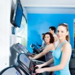 Stock Photo: Group of in gym doing cardio training