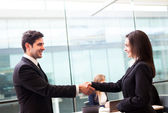 Business handshake at modern office with bussiness — Stock Photo
