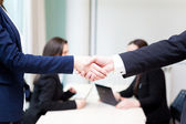 Business handshake at the office with bussiness — Stock Photo