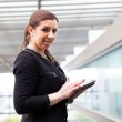 Business woman working with a digital tablet at modern office — Stock Photo #22329801