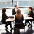 Royalty-Free Stock Photo: Business partners discussing ideas at meeting
