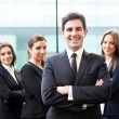 Businessman leader on the foreground of his team — Stock Photo