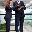 Smiling business partners working with electronic tablet at mode — Stock Photo