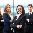 Group of business smiling at the office — Stock Photo #23786581