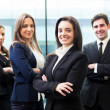 Group of business smiling at the office — Stock Photo