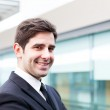 Smiling young business man portrait — Stock Photo