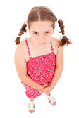 Full body portrait of a little girl looking up against white bac — Stock Photo