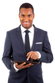 Happy smiling african american young businessman with tablet com — Stock Photo