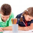 Two children drawing with colorful crayons, isolated over white  — Stock Photo
