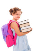 Image of schoolgirl with backpack carring books, isolated on whi — Stock Photo