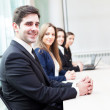 Group of business smiling at the office lined up — Stock Photo