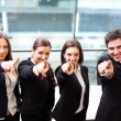Businesspeople pointing at you and smiling — Stock Photo