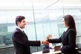 Business shaking hands, finishing up a meeting at the off — Stock Photo