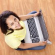 Young happy smiling woman with laptop working at home — ストック写真