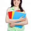 Young happy female student carrying books, isolated on white bac — Stock Photo