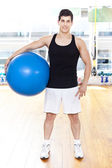 Smiling handsome man with Pilates ball — Stock Photo