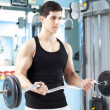 Handsome mlifting heavy free weights at gym — Stock Photo #30082739