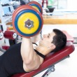 Strong mlifting heavy free weights at gym — Stock Photo #30082741