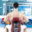 Handsome man training with weights at the gym — Stock Photo