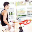 Handsome young man doing sport Spinning in the gym for fitness — Stock Photo #30082783