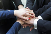 Business partners making pile of hands at meeting — Stock Photo