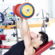 Strong mlifting heavy free weights at gym — Stock Photo #31083303