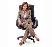 Attractive business woman sitting in chair — Stock Photo