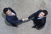 Business handshake between two businessman outdoors — Stock Photo