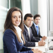 Business team smiling — Stock Photo #33265803