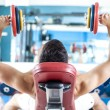 Stong man lifting weights in the gym — Stock Photo #33266255