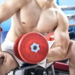 Strong man lifting weights in the gym — Stock Photo