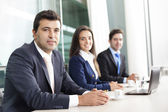 Business team smiling at the office — Stock Photo