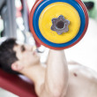Strong man training with weights in the gym — Stock Photo
