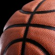 Basketball ball against dark background — Stock Photo