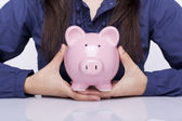 Woman holding a piggy bank — Stock Photo