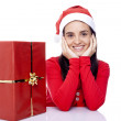 Happy Santa girl with gift — Stock Photo