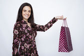 Young woman smiling with shopping bags — Stock Photo