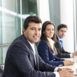Stock Photo: Business team smiling at office, lined up