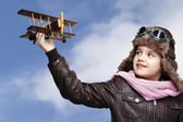 Happy child playing with toy airplane outdoors — Stock Photo