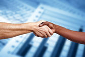 Handshake between multiracial people — Stockfoto