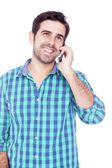 Yakışıklı adam cep telefonuyla konuşuyor — Stok fotoğraf