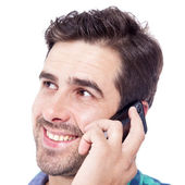 Latin man talking on cell phone — Stock Photo
