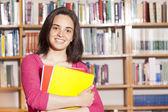 Student holding books — Foto Stock